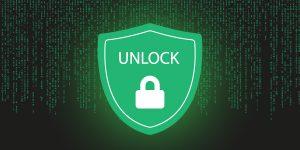 """Schloss mit der Beschriftung """"Unlock"""" vor Computerhintergrund"""